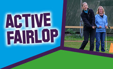 A couple golfing as part of the Active Fairlop programme, golfing in Fairlop.