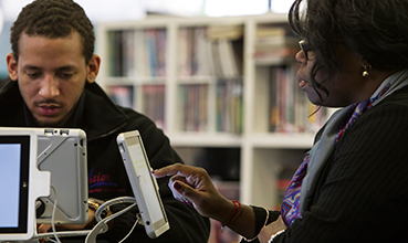 People using tablet devices in a library