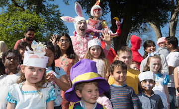 children dressed up in alice in wonderland character costumes