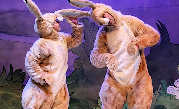two actors dressed as hares portraying a childrens book