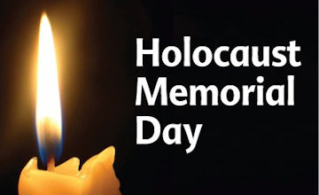 Single lit candle to mark Holocaust Memorial Day